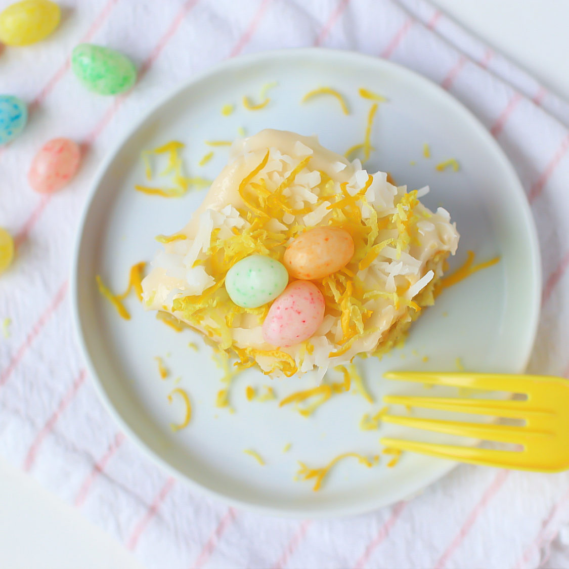 overhead picture of easter lemon cake with jelly beans on top